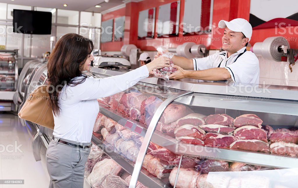 Happy customer at the butchers stock photo