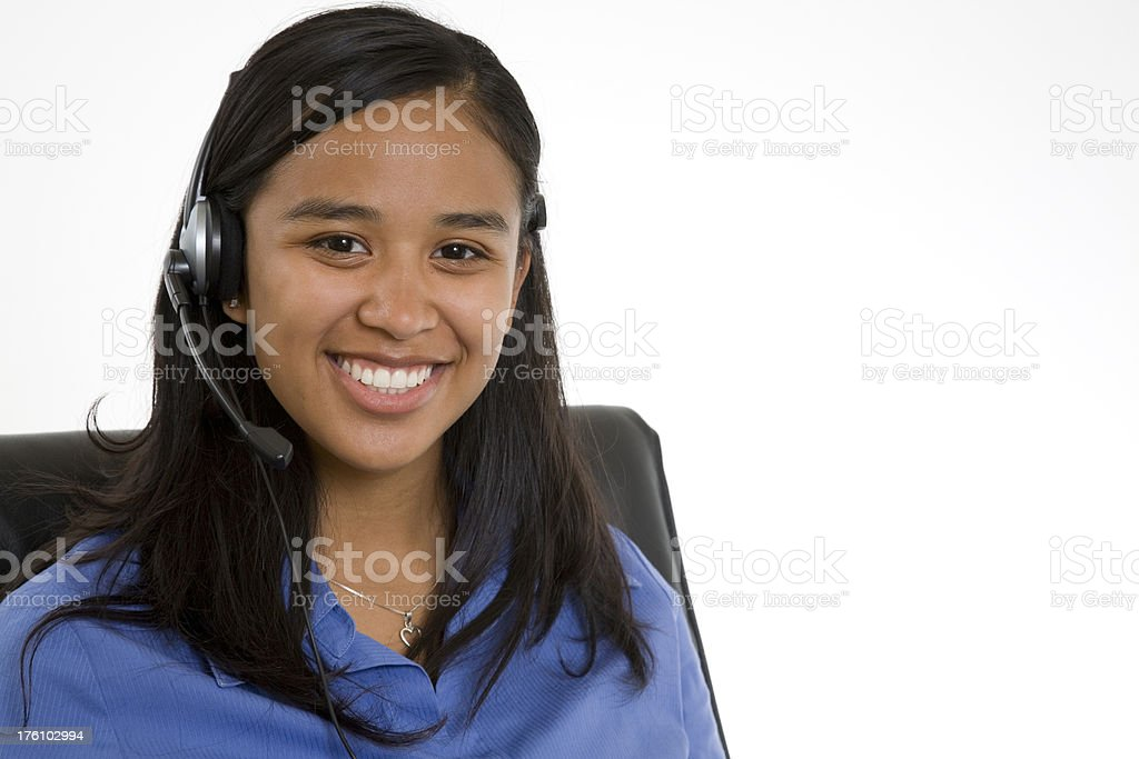 Happy Customer Service Person Sitting in Her Chair royalty-free stock photo