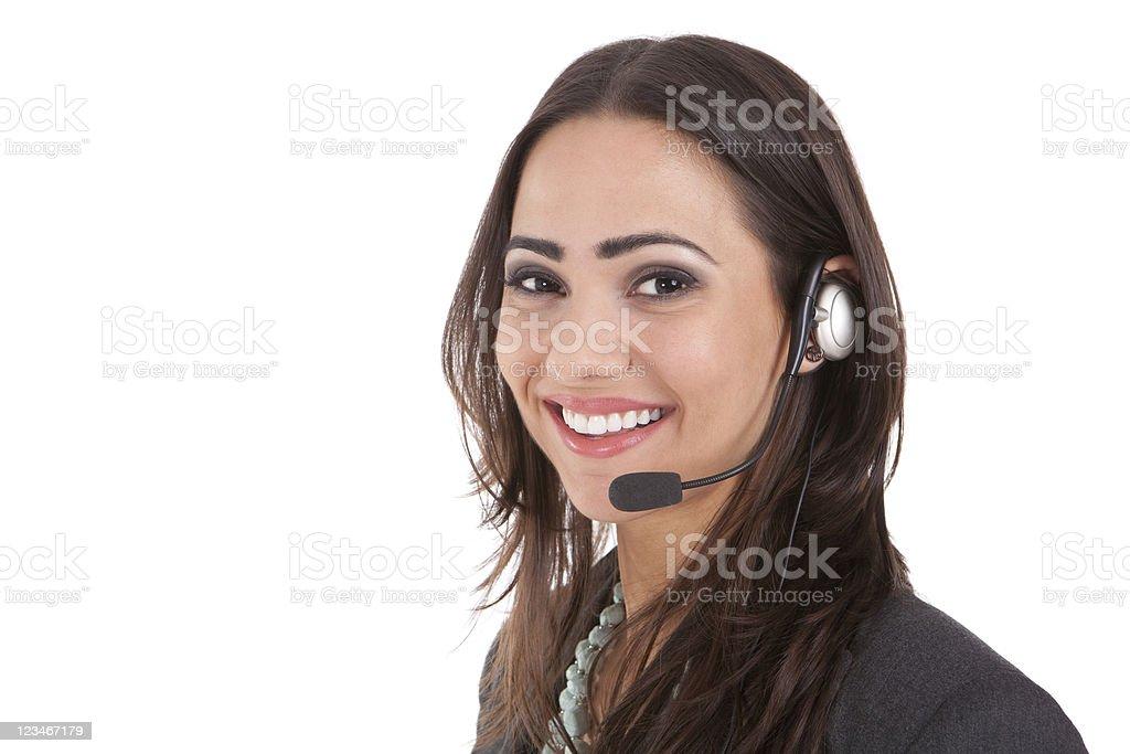A happy customer service representative wearing a headset stock photo