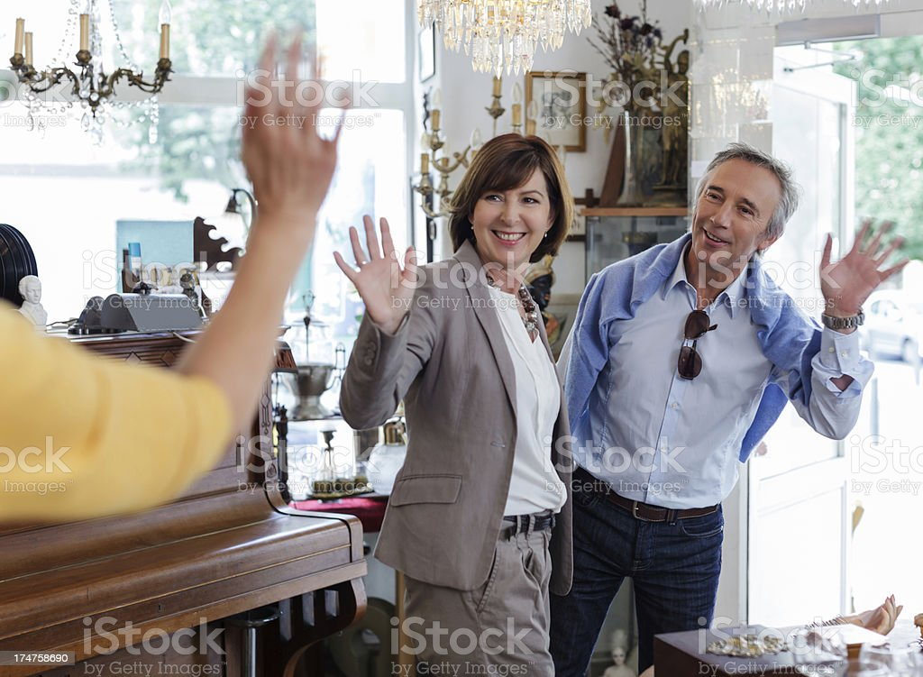 Happy Customers leaving Antique store stock photo