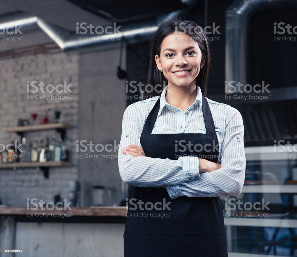Happy cute female waiter in apron stock photo