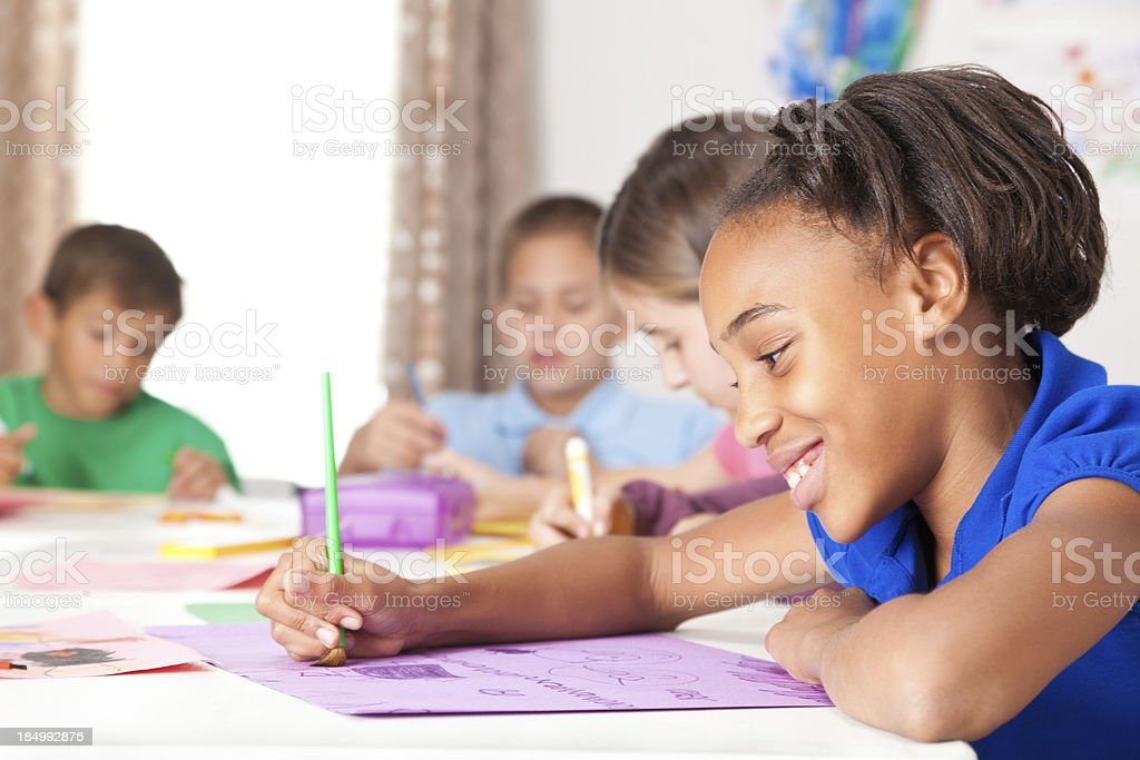 Happy cute girl drawing in art class royalty-free stock photo