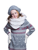 Happy cute kid posing in the studio. Wearing winter clothes.