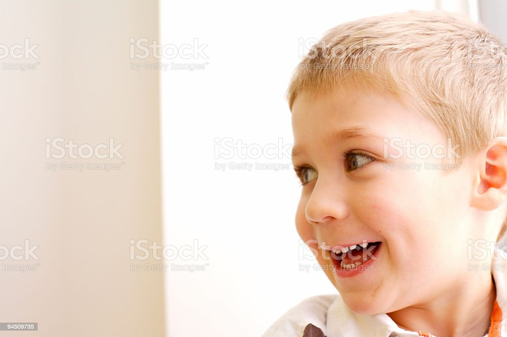 happy cute little boy looking on the side stock photo