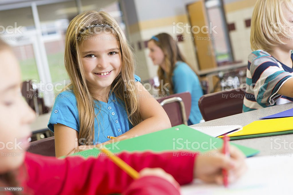 Happy cute student at school with other students royalty-free stock photo
