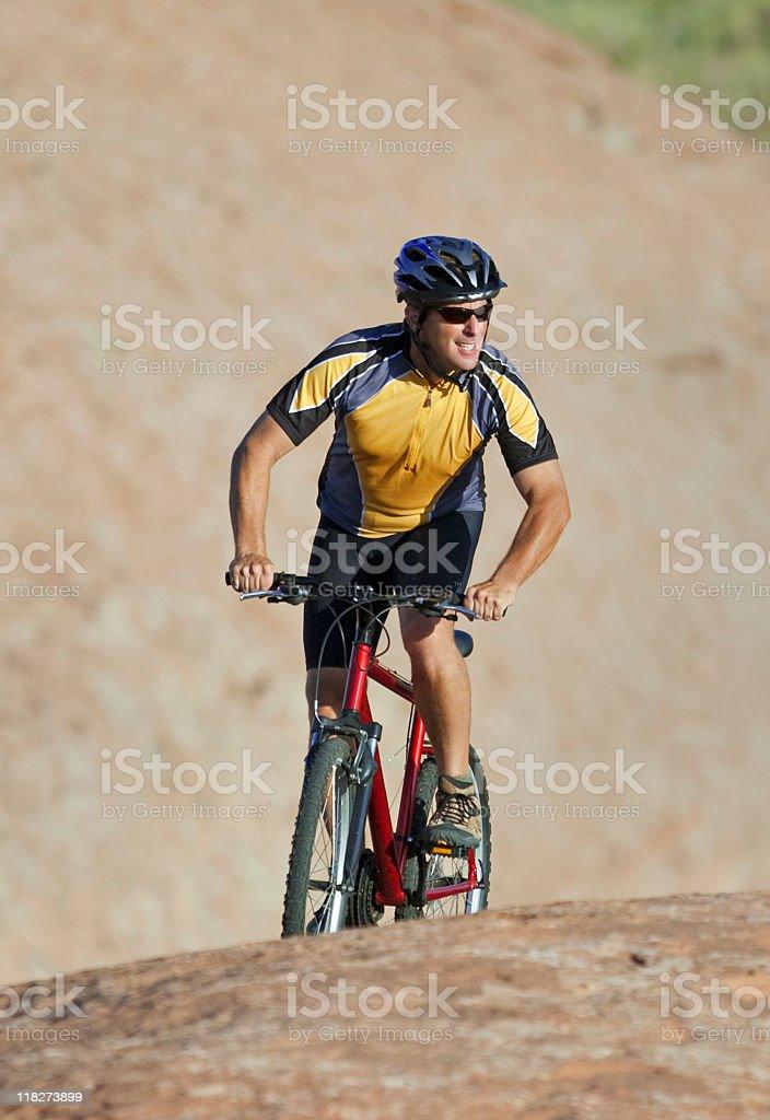 Happy Cyclist Riding Mountain Bike In Moab, Utah royalty-free stock photo