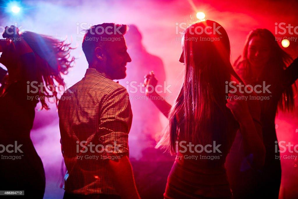 Happy dancers stock photo