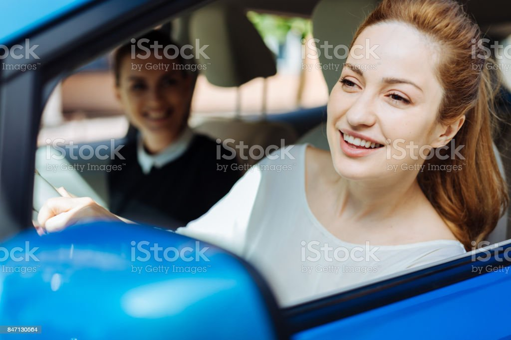 Happy delighted woman enjoying her ride stock photo