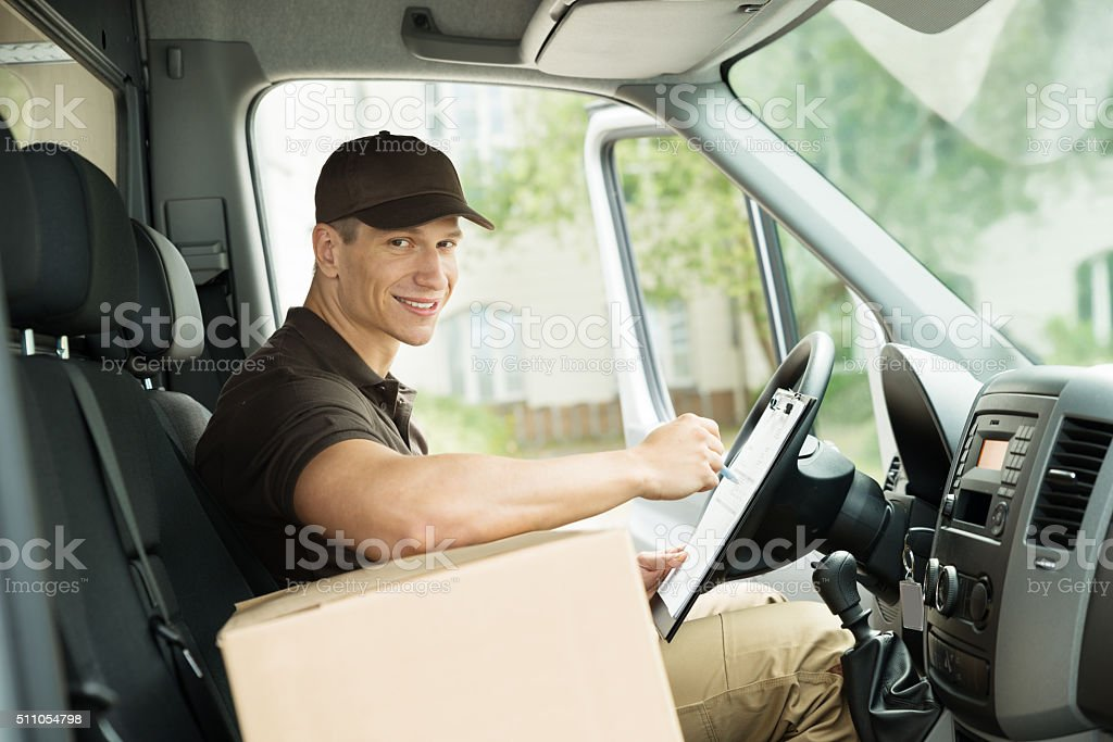 Happy Delivery Man Checking List stock photo