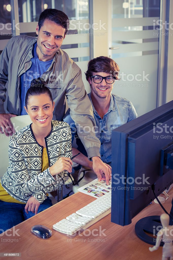 Happy designers working together stock photo