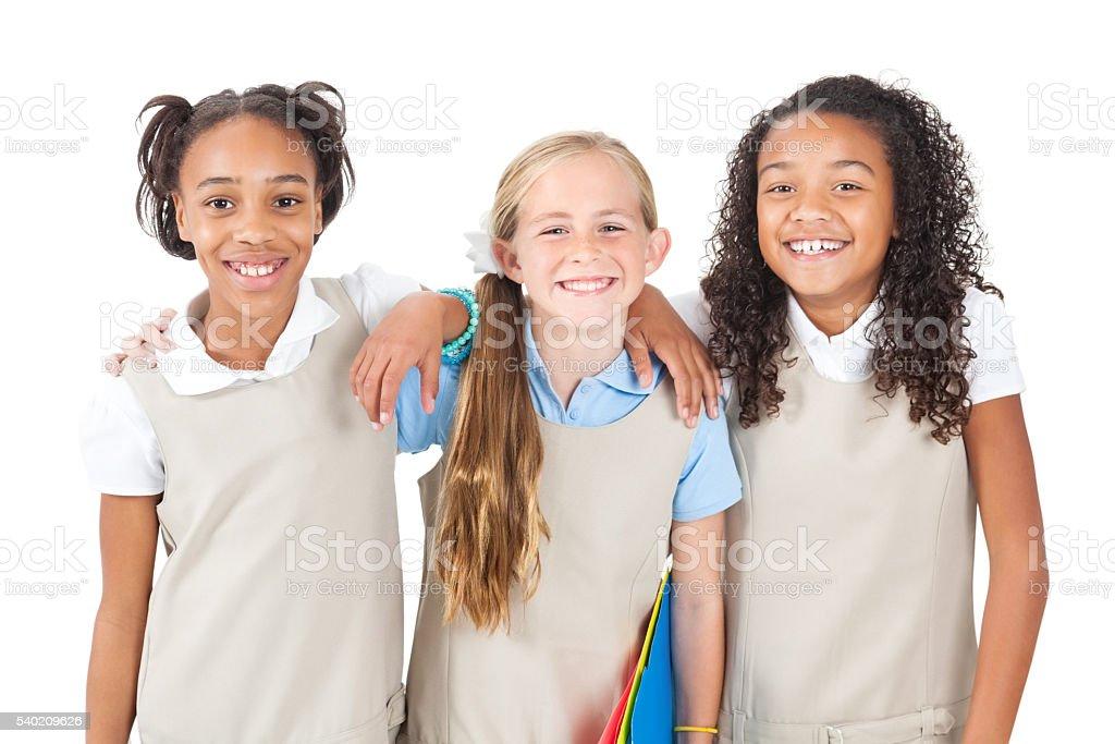 Happy diverse group of schoolgirls stock photo