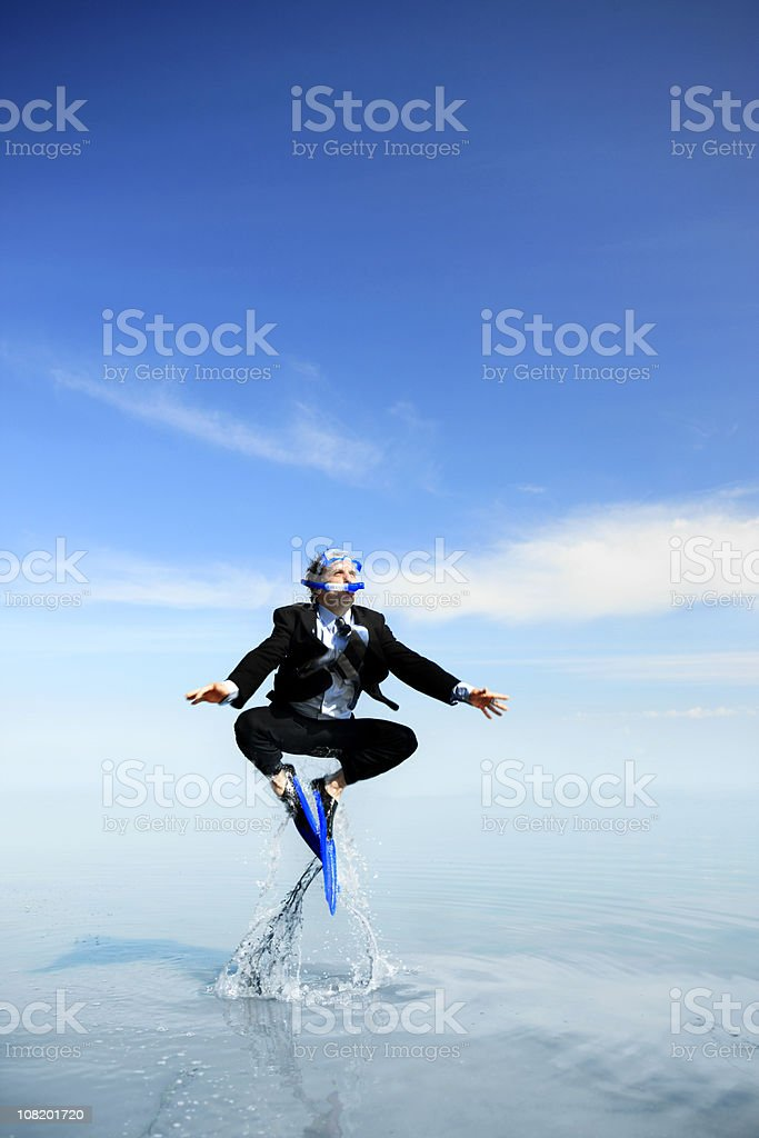 Happy Diving Businessman stock photo