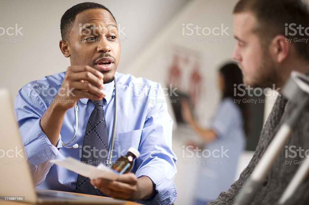 happy doc with young male patient royalty-free stock photo