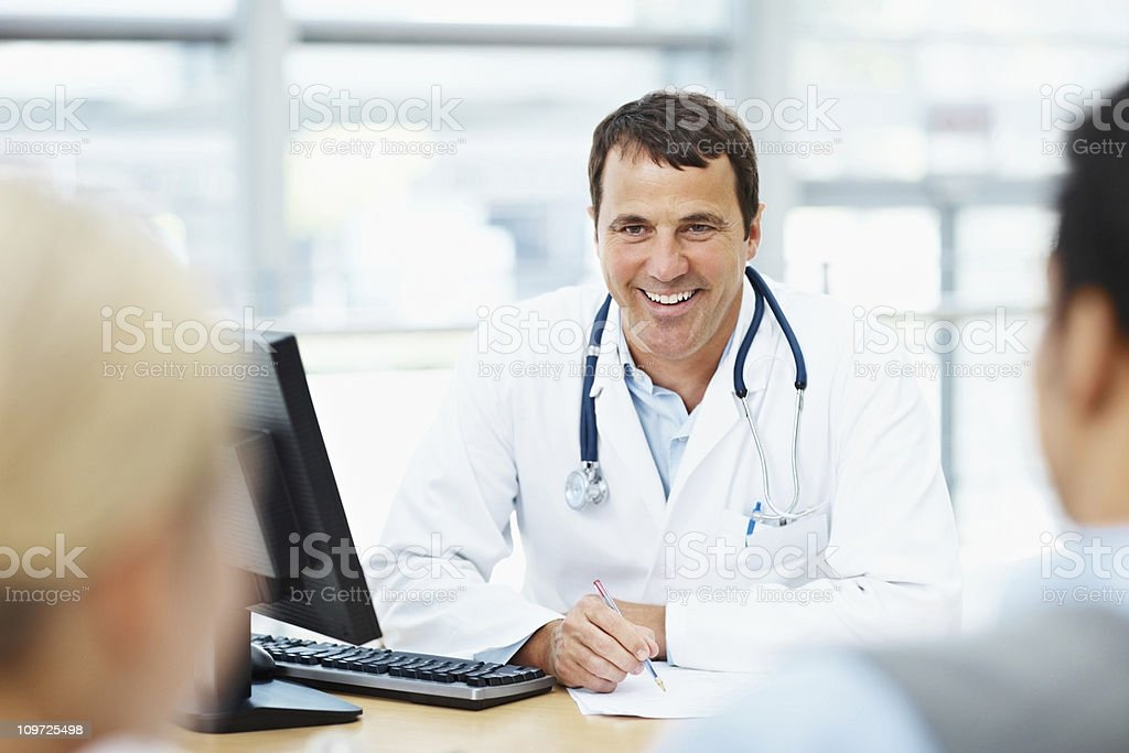 Happy doctor having a discussion with patience royalty-free stock photo