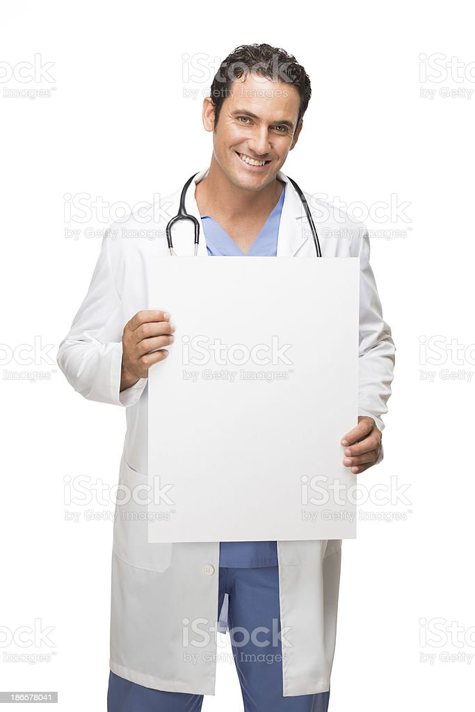 Happy doctor holding a blank sign royalty-free stock photo