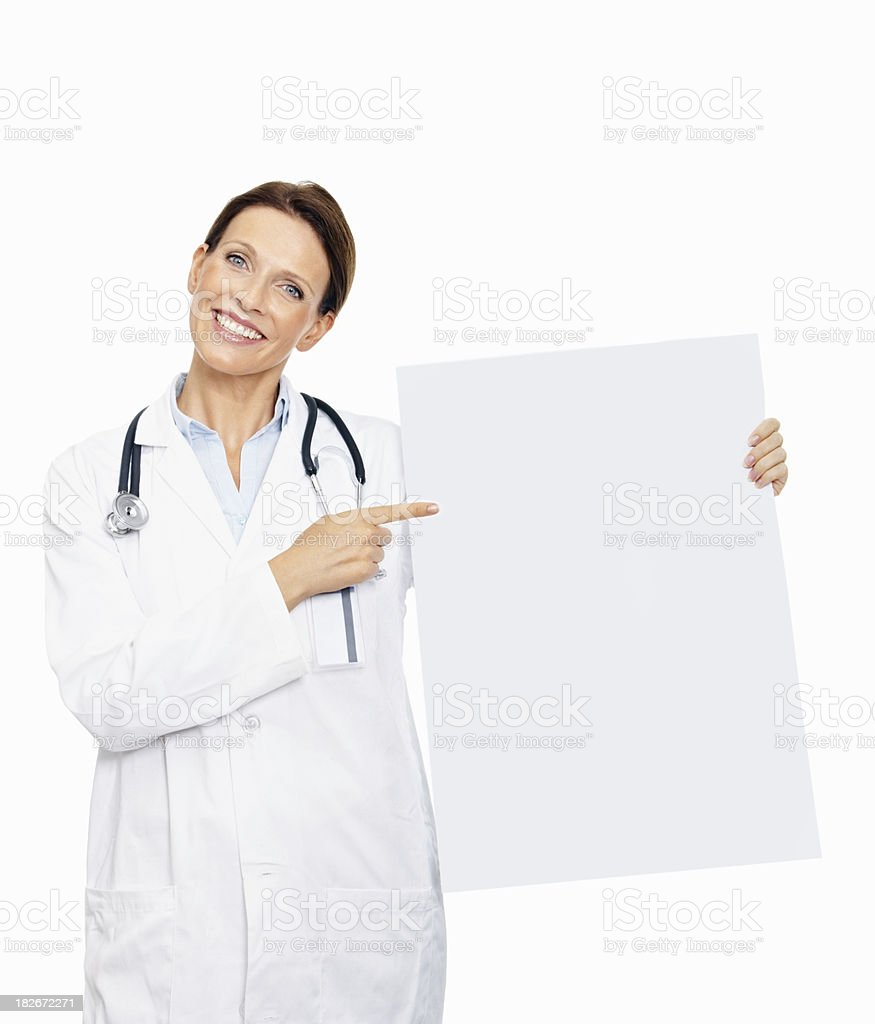 Happy doctor holding an advertisement board royalty-free stock photo