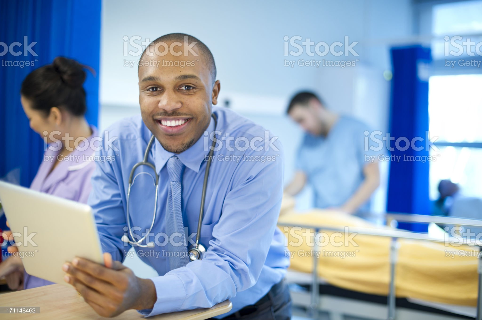 happy doctor on a busy ward royalty-free stock photo