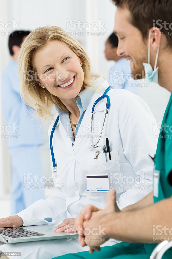 Happy Doctor Talking With Surgeon royalty-free stock photo