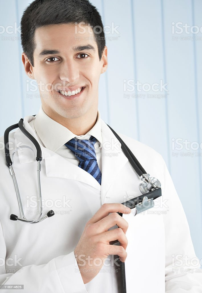 Happy doctor with clipboard at office royalty-free stock photo