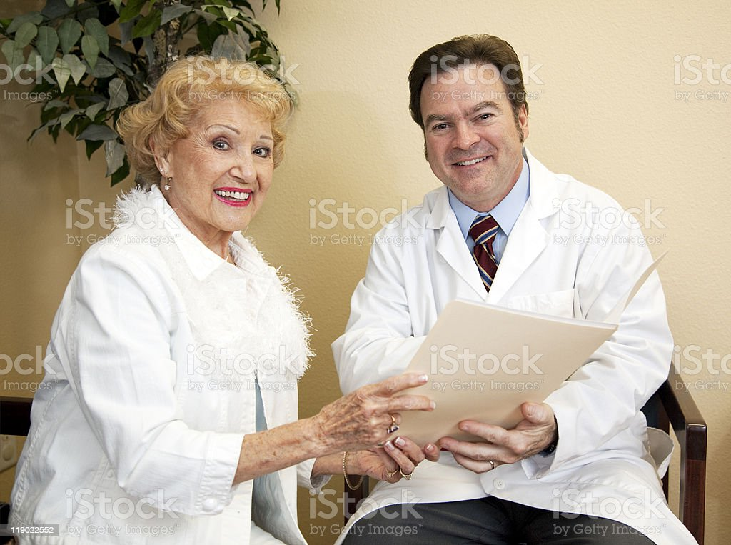 Happy Doctor With Patient royalty-free stock photo