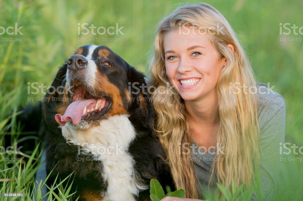 Happy Dog Lying Outside stock photo
