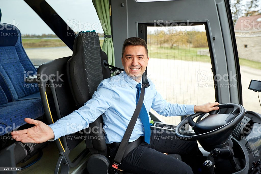 happy driver inviting on board of intercity bus stock photo