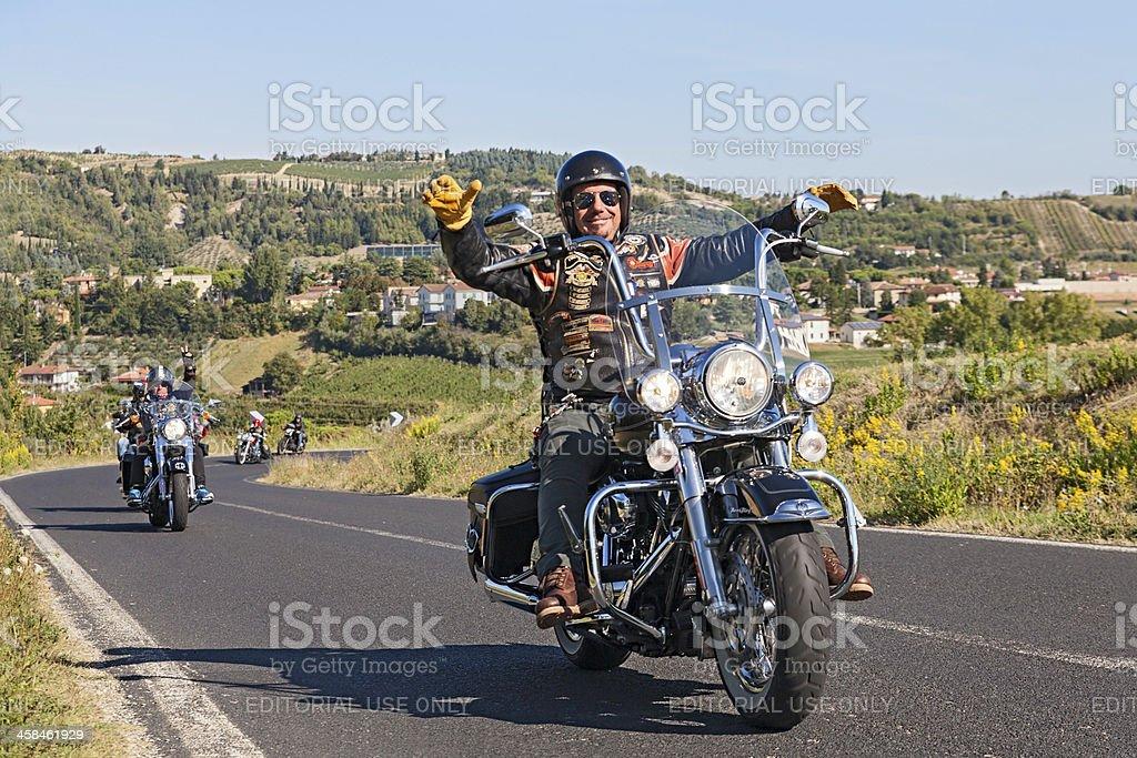 happy driver riding Harley Davidson stock photo