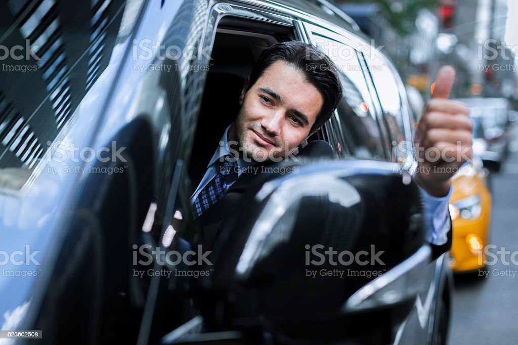 Happy driver showing thumb up stock photo