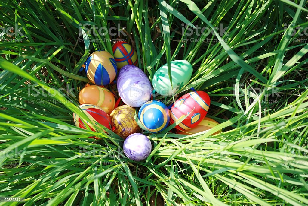 Happy Easter colorful easter eggs in the grass stock photo
