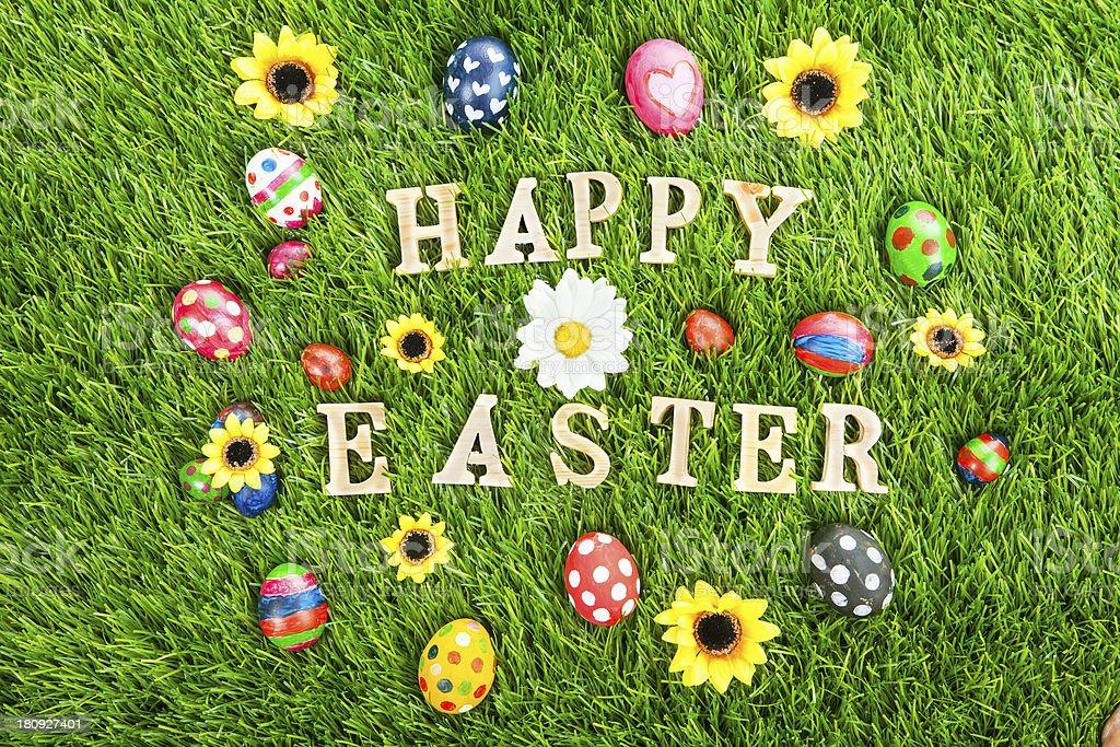 Happy Easter eggs on grass horizontal stock photo