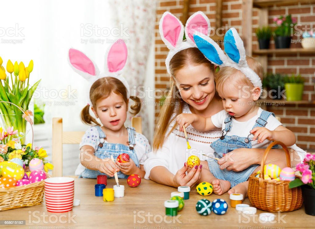 Happy easter! family mother and children paint eggs for holiday Easte stock photo