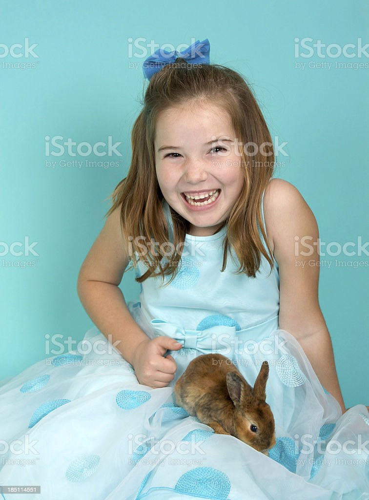 Happy Easter Girl with a Bunny and Blue Dress royalty-free stock photo