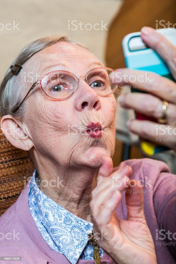 Happy Elder Woman taking Selfie stock photo