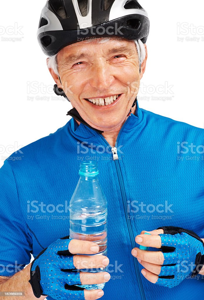Happy elderly cyclist with a bottle of drinking water royalty-free stock photo