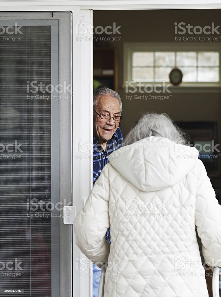 Happy Elderly Husband Welcoming His Woman Home royalty-free stock photo