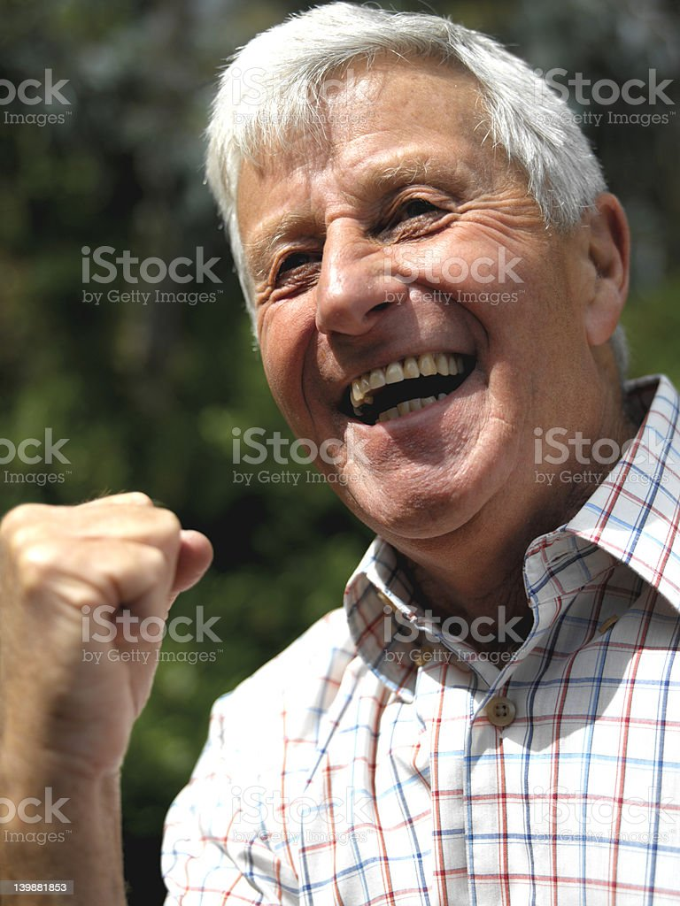 happy elderly man, clenched fist in celebration royalty-free stock photo