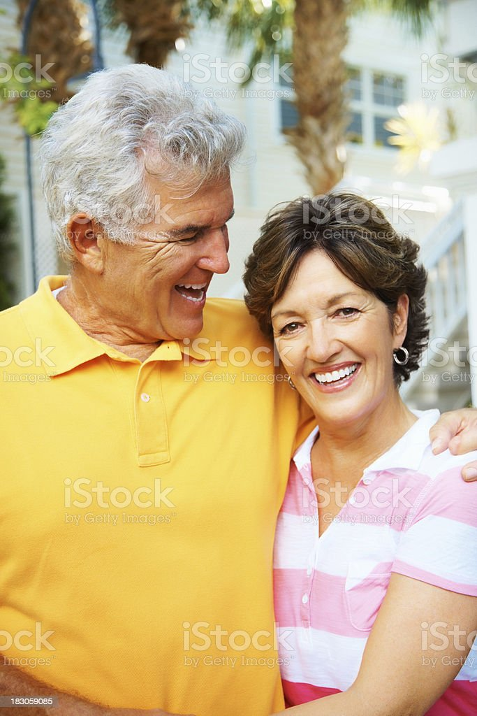 Happy elderly man looking at a mature woman smiling royalty-free stock photo