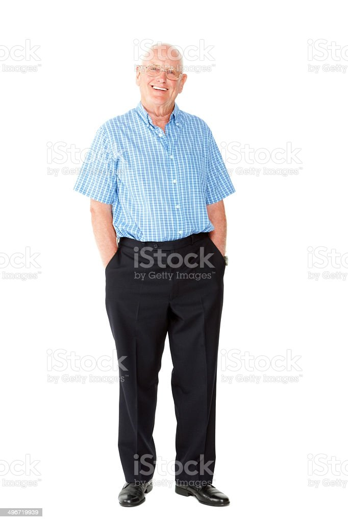 Happy elderly man standing with his hands in pockets stock photo
