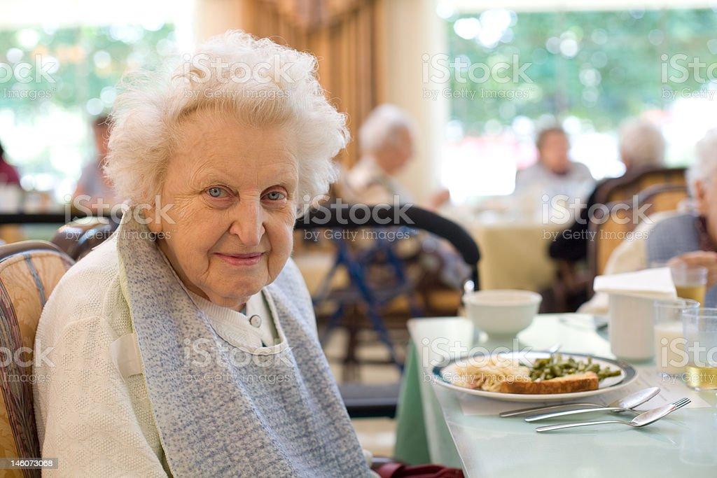 Happy elderly woman enjoying a meal 1 stock photo