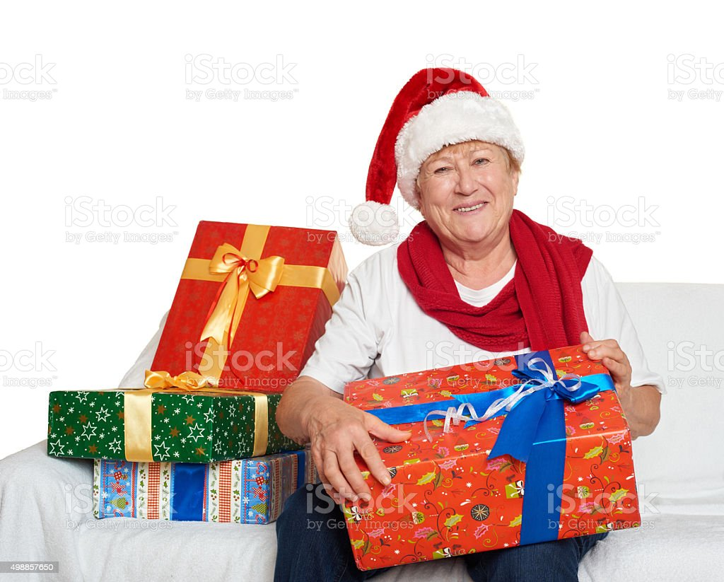 happy elderly woman with christmas box gift - holiday concept stock photo