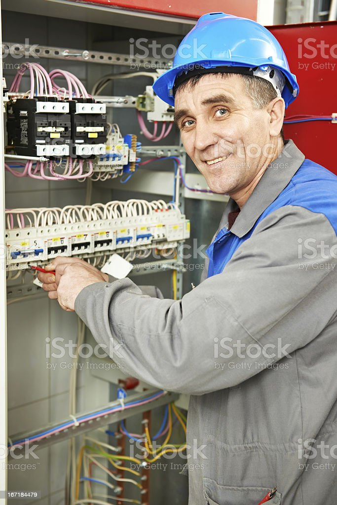 Happy electrician working at power line box royalty-free stock photo