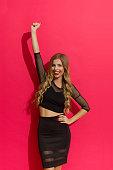 Happy Elegant Woman Rising Fist