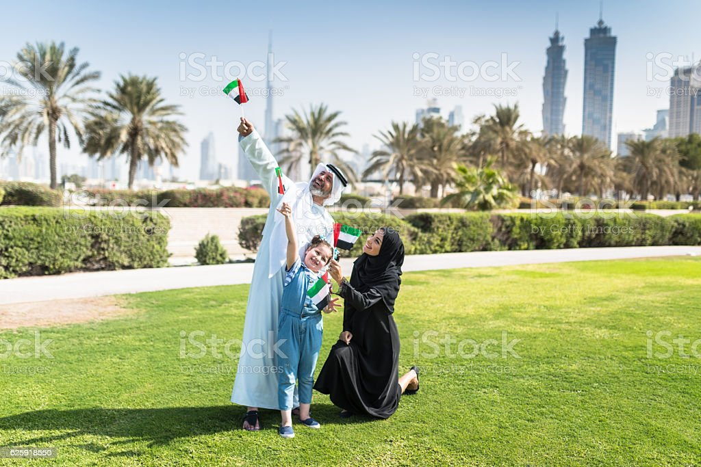 happy emirate family celebrate the national day stock photo