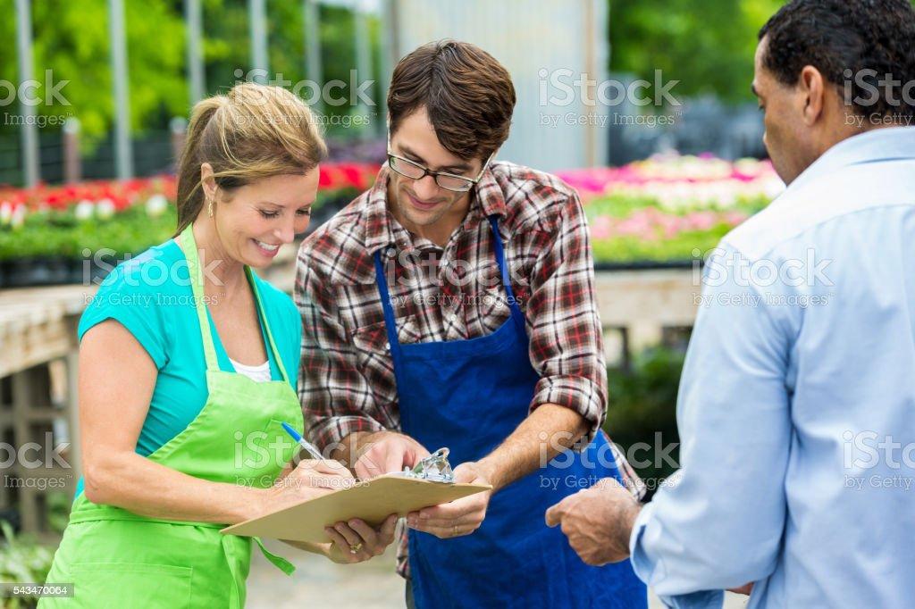 Happy employees of a local garden center stock photo