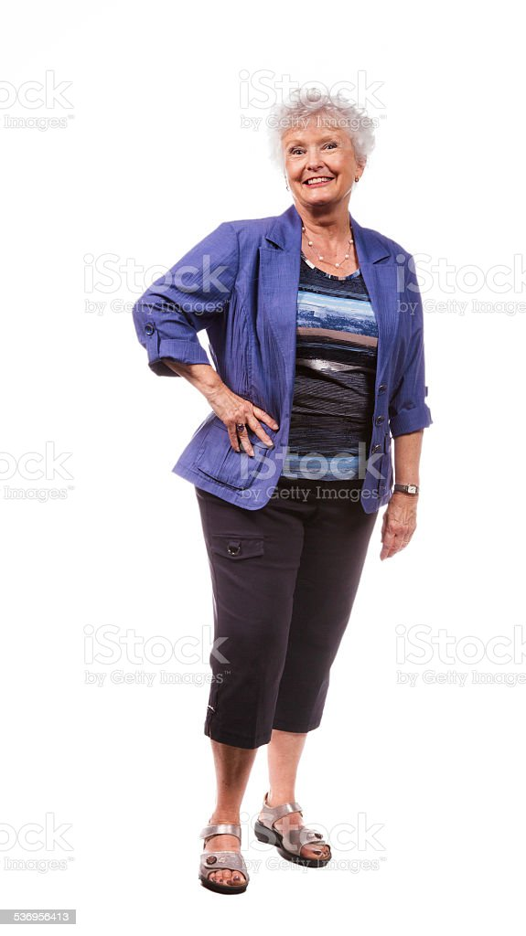 Happy energetic senior woman in Summer clothing full length isolated stock photo