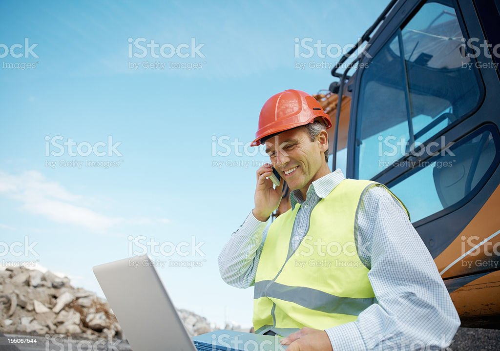 Happy engineer working at construction site royalty-free stock photo