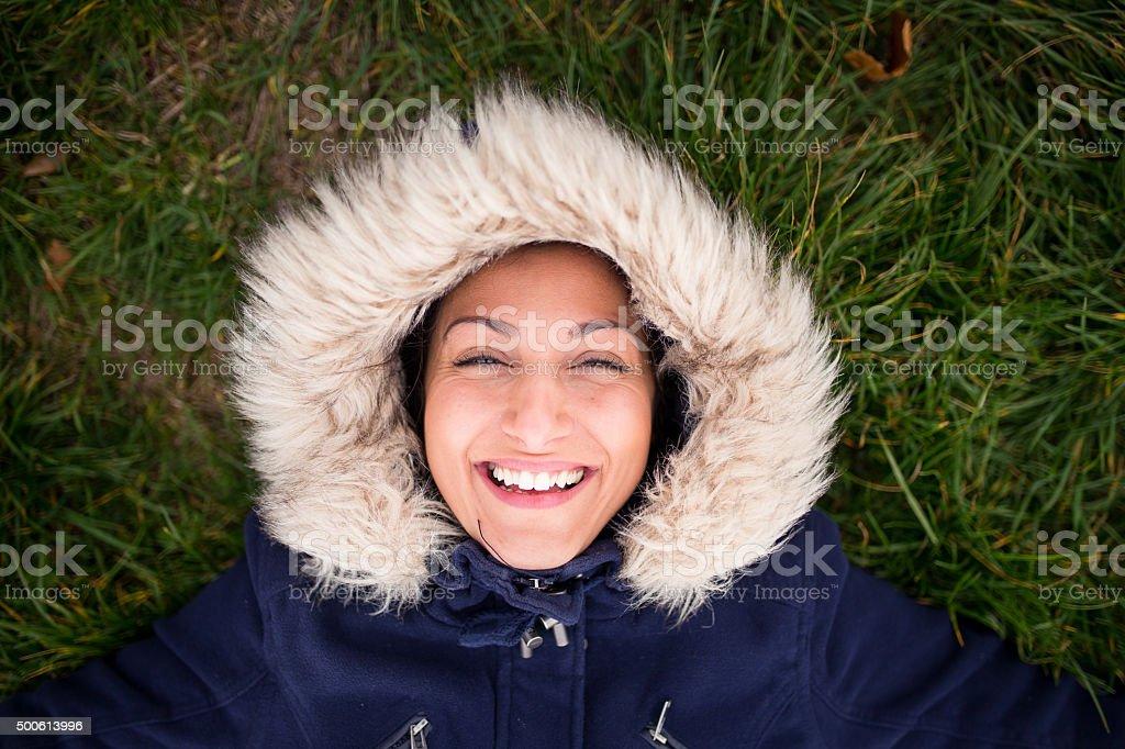 Happy eskimo girl on the ground,laughing stock photo