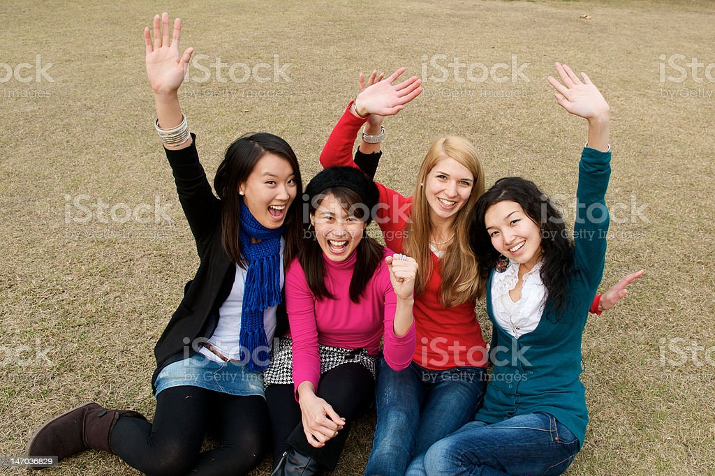 Happy ethnically diverse group of women outdoors royalty-free stock photo