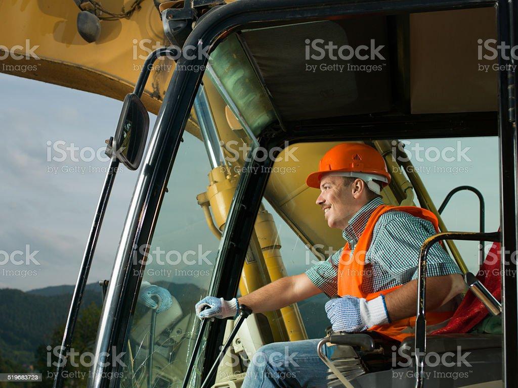 happy excavator driver stock photo