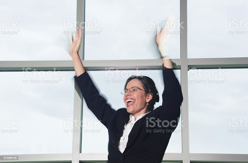 Happy, excited  businesswoman waving hands, perhaps greeting someone stock photo